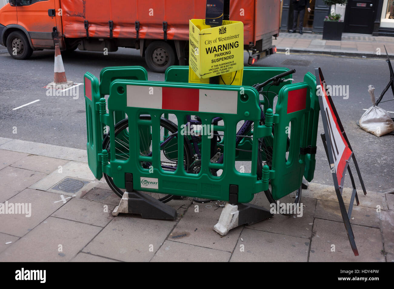 A Bike Has Been Fenced In Between Some Construction Barriers And