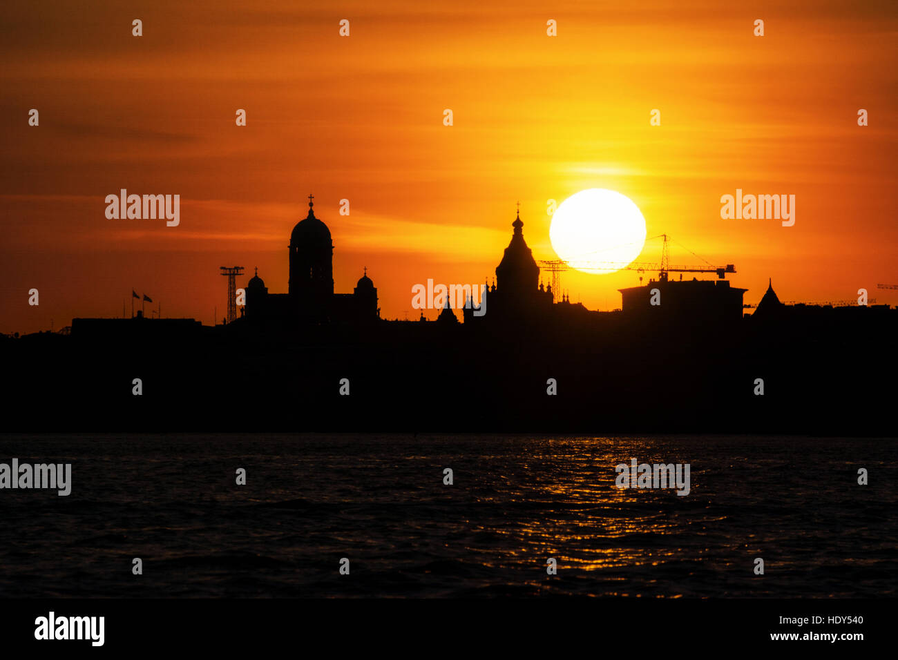 The Silhouette of the Cathedral of Helsinki and its nearby houses - Stock Image