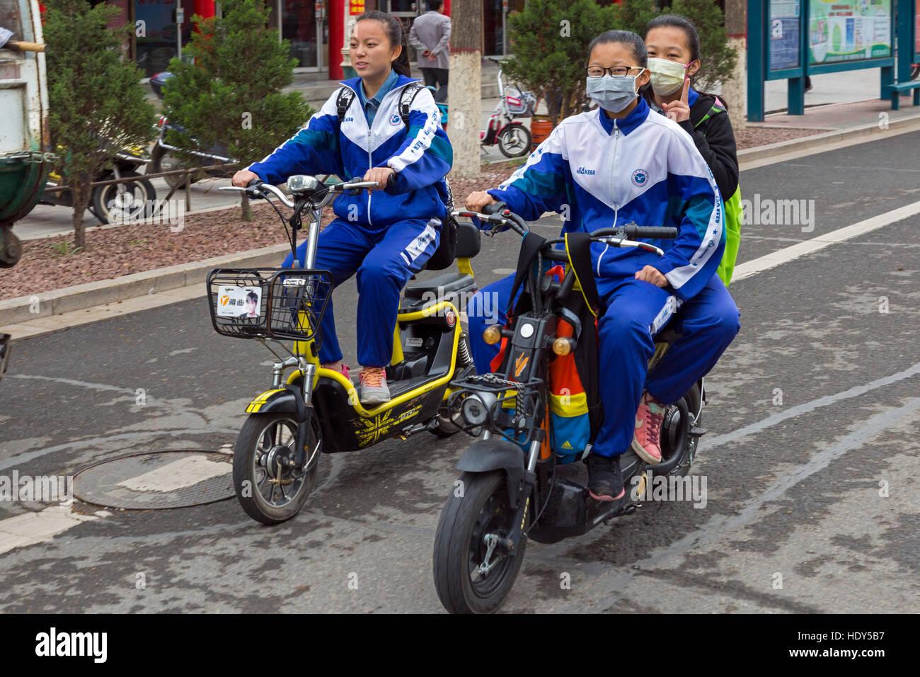 Schoolgirls on bikes, Zhongwei, Ningxia, China - Stock Image