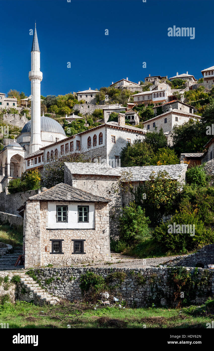 scenic view of pocitelj village traditional old architecture buildings and mosque in Bosnia Herzegovina - Stock Image
