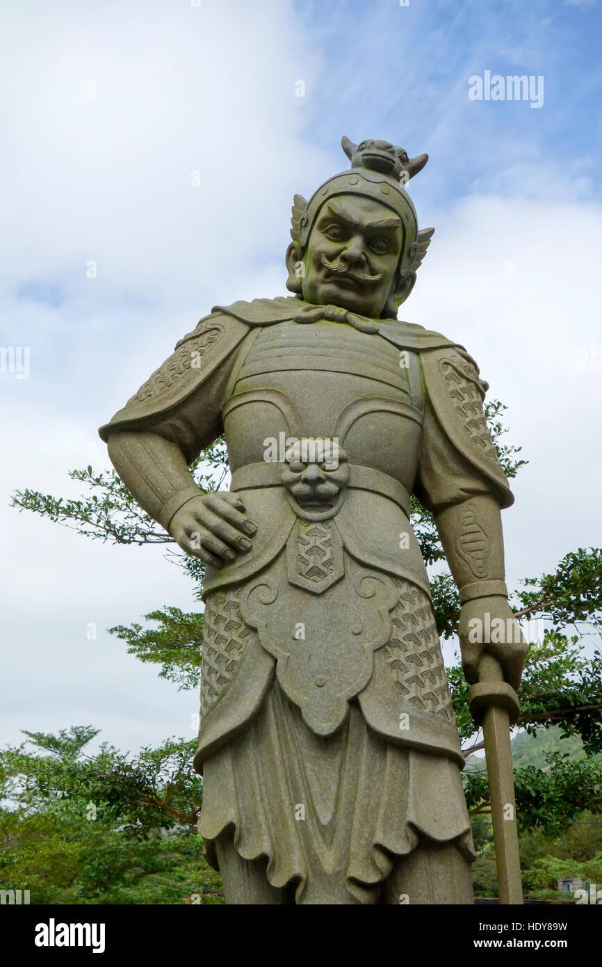 Statue on walkway to Tian Tin monastery and the Big Buddha at Ngong Ping village on Lantau Island, Hong Kong. - Stock Image
