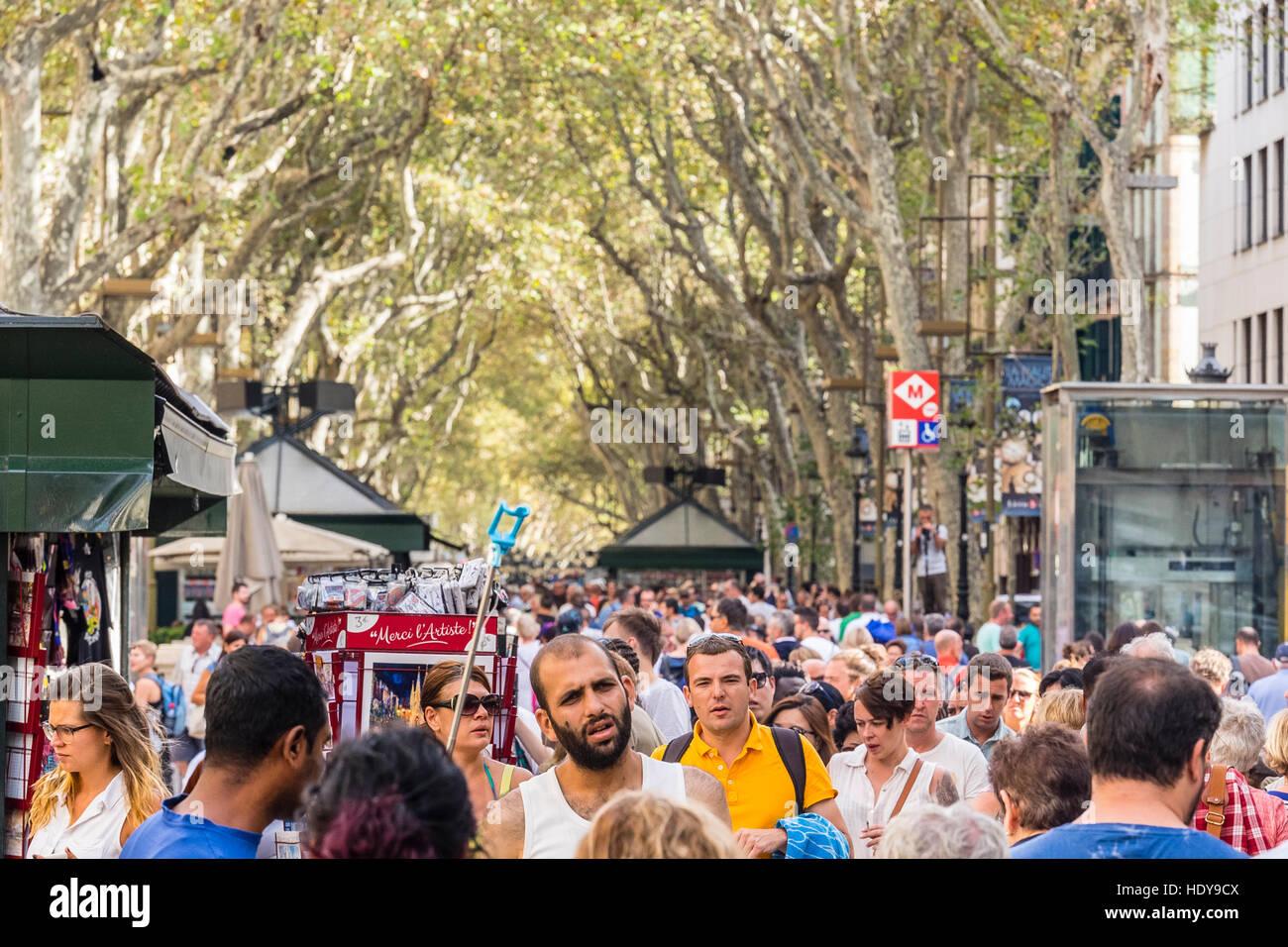 tree-linedCrowd of pedestrians on the famous walking street, Las Ramblas, in Barcelona, Spain. - Stock Image