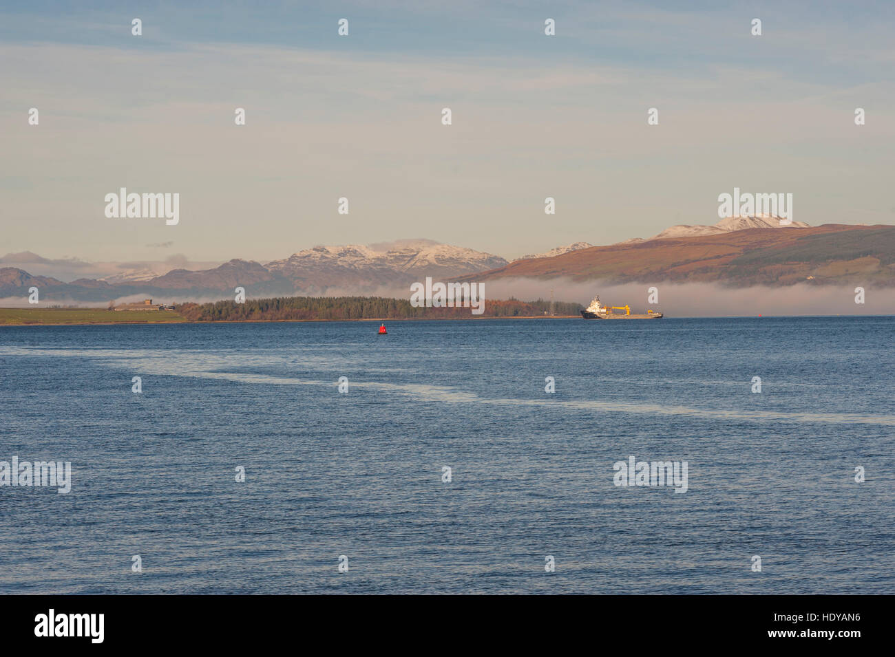 Looking across the river clyde towards Rosneath and the Gare Loch from greenock, with a bank of fog hangong low - Stock Image