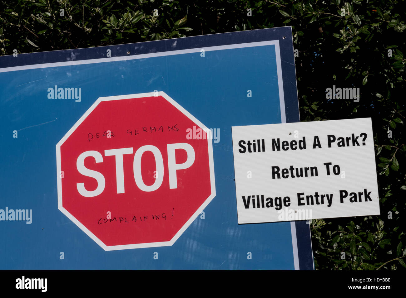 Stop sign with added graffiti requesting that Germans stop complaining.  This was seen on Coramandel Peninsula, - Stock Image
