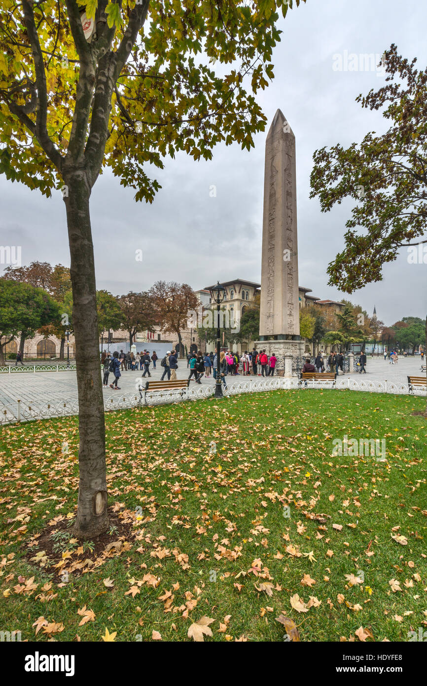 Autumn leaves and Egyptian obelisk at Sultanahmet square,Istanbul,Turkey - Stock Image