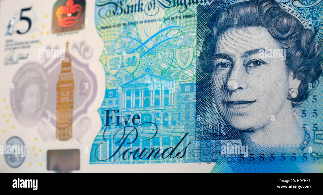 The new five pound note, new fiver, is seen in a photograph posed in a studio in London, Britain December 12, 2016. - Stock Image