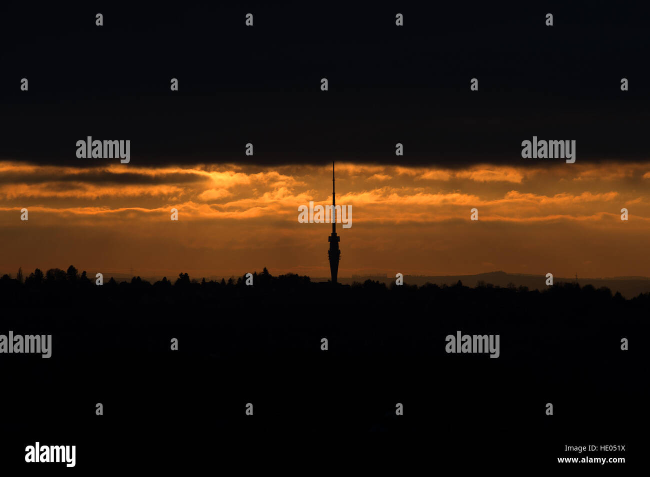 Dresden, Germany. 15th Dec, 2016. The TV tower stands out on stark contrast against the sky at sunset, bracketed - Stock Image