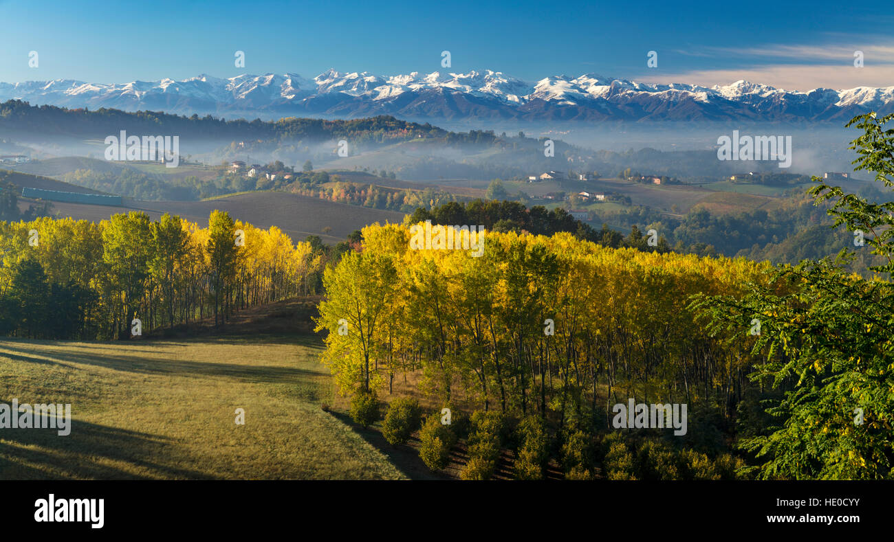 Autumn view across the Po Valley to the Ligurian Alps near Monforte d'Alba, Piemonte, Italy - Stock Image