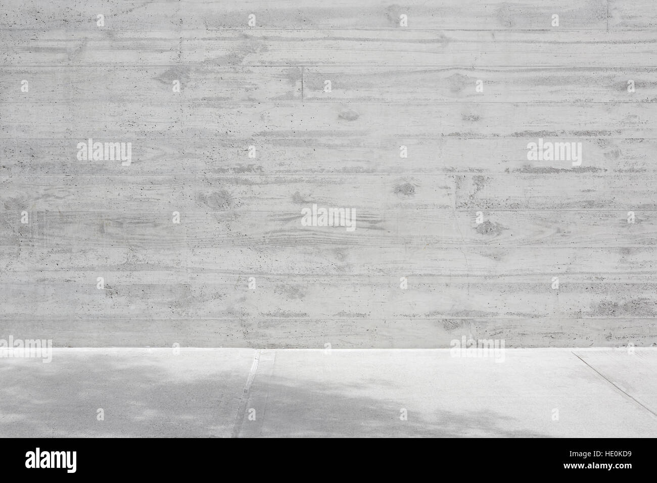 Gray concrete rough wall with wooden veining and empty floor background - Stock Image