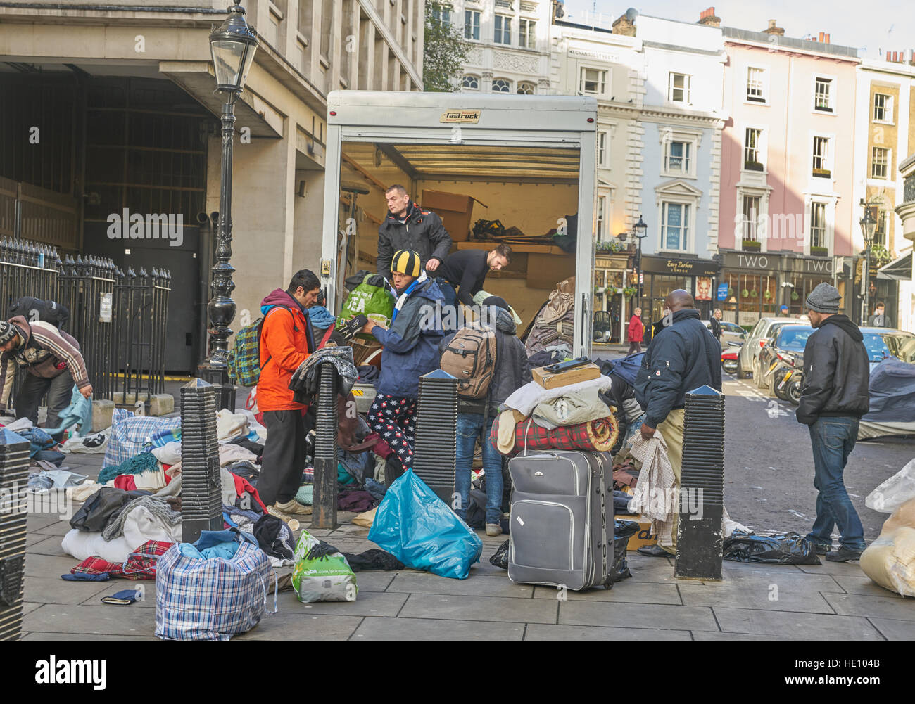 clothing charity, clothes distribution to homeless people. - Stock Image