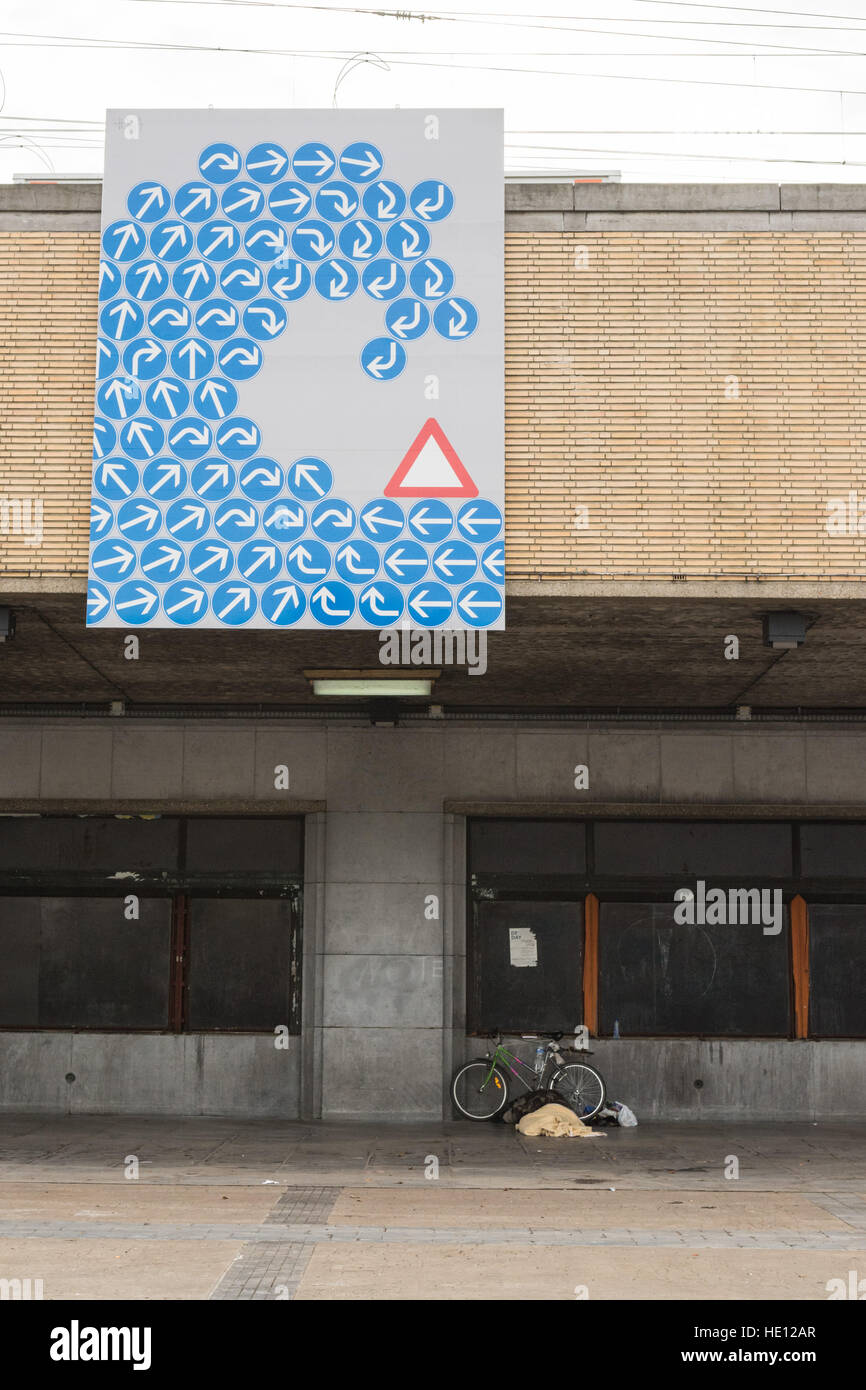 Brussels midi south station - modern street art and rough sleeper with bike, Belgium - Stock Image