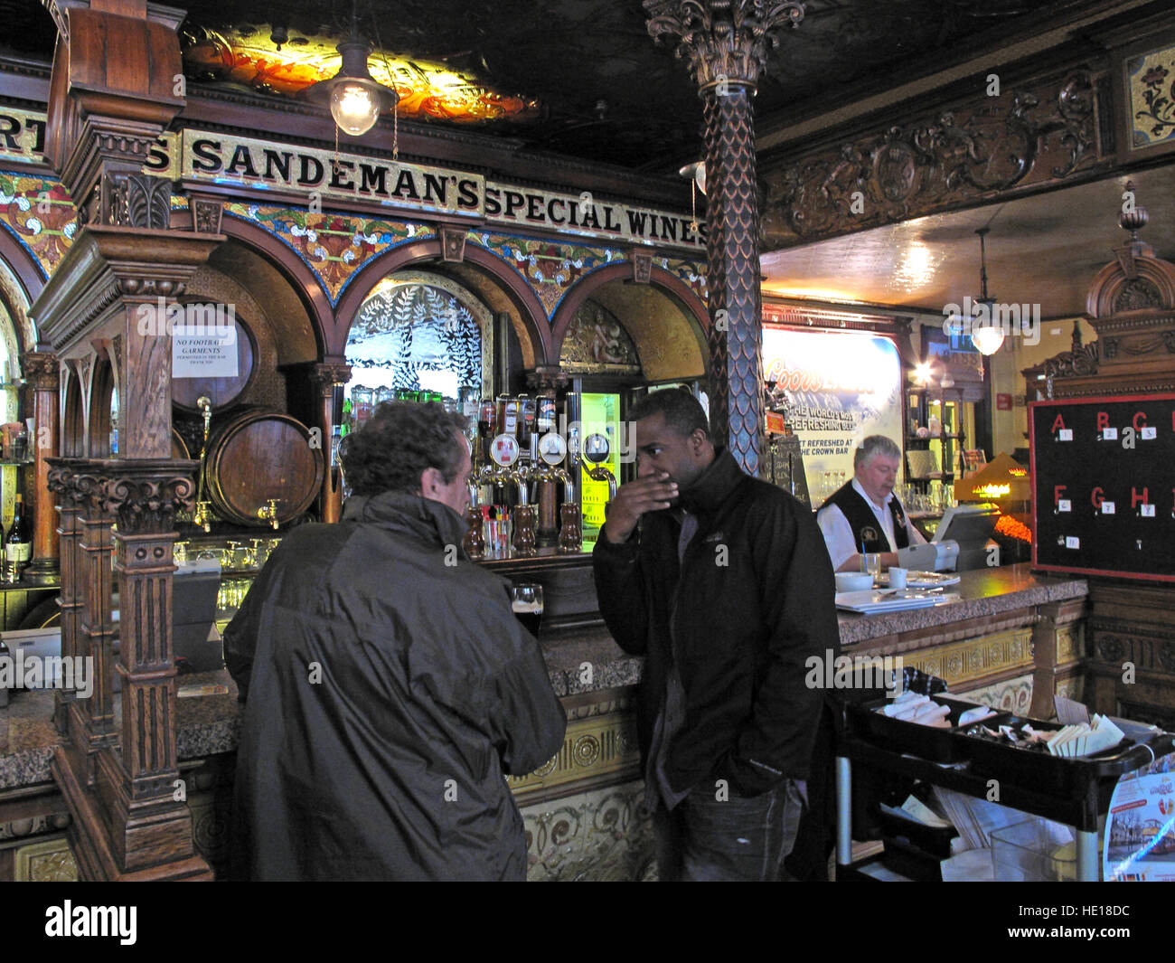 Chatting Drinkers In the Crown Saloon,Great Victoria St,Belfast,Northern Ireland,UK Stock Photo