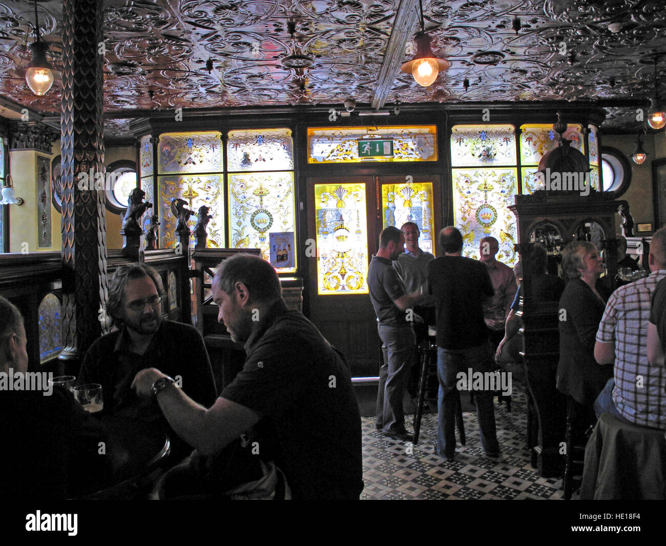 Drinkers in the Famous Crown Bar,Gt Victoria St,Belfast - Stock Image