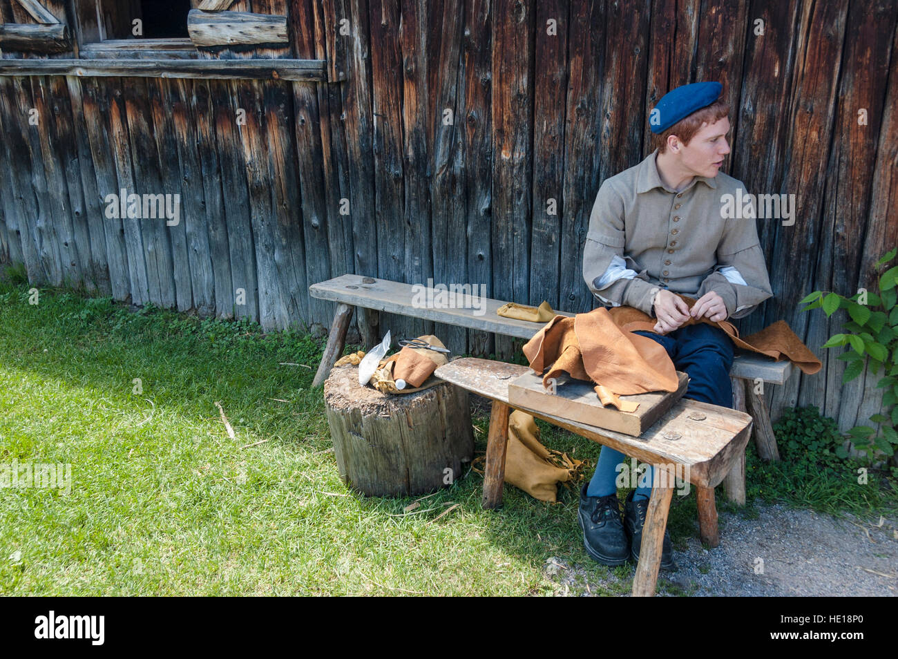 A male teenager volunteer role plays a 1600's settler at Saint-Marie Among the Hurons, a living museum in Midland, - Stock Image