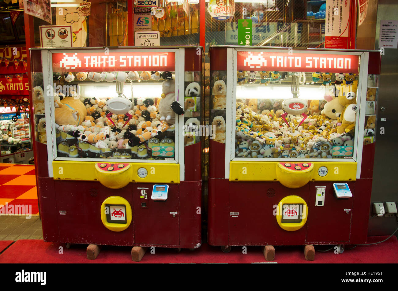 Claw Game or cabinet catches the doll japanese called Kureen geemu in arcade area for people playing at Ameyoko - Stock Image