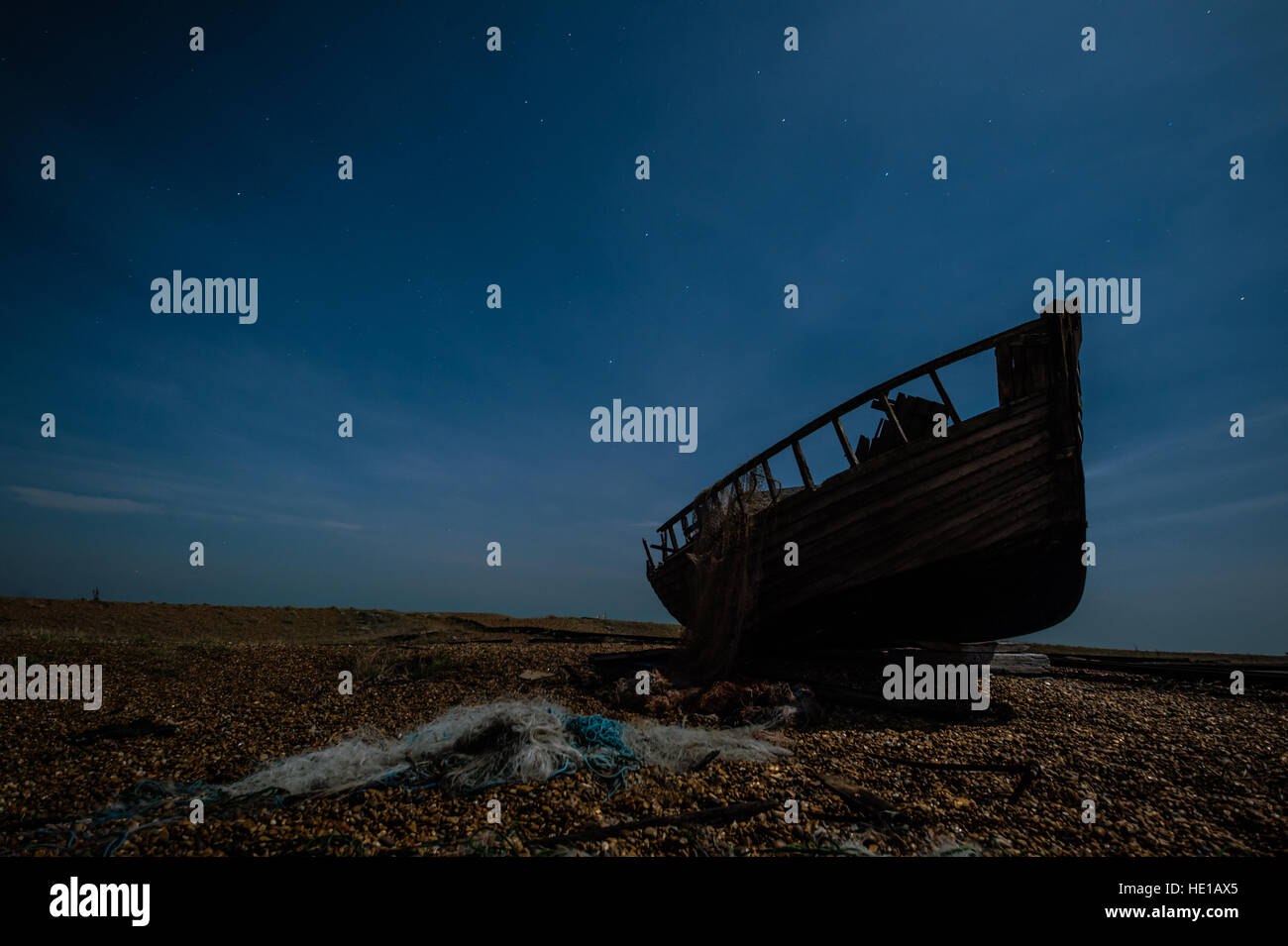Old boat at night on Dungoness beach. Stock Photo