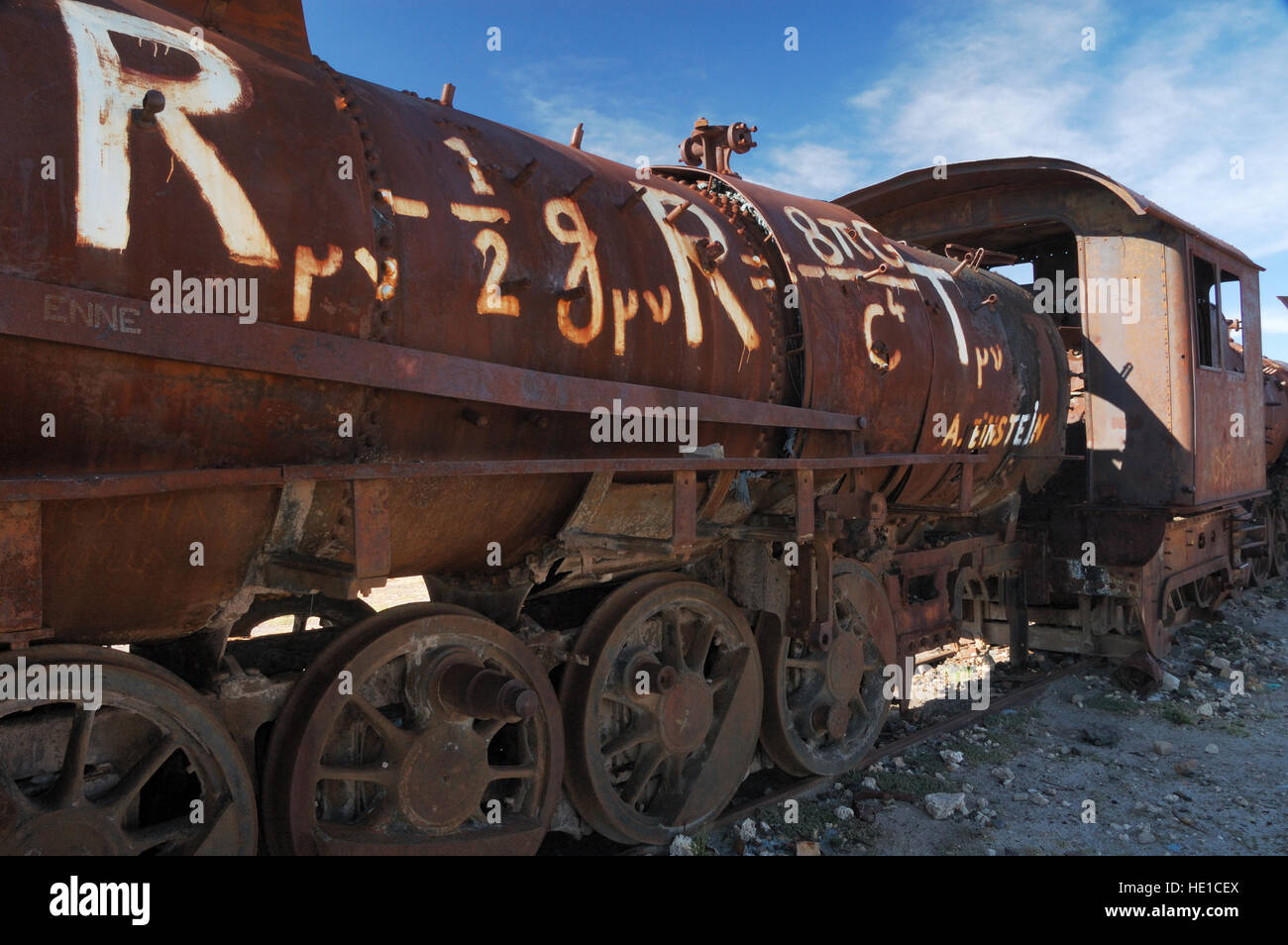 Theory of relativity on a rusty locomotive, train cemetery, Salar de Uyuni or Salar de Tunupa, Altiplano, Bolivia, - Stock Image