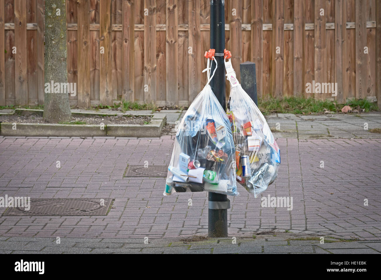 Large bags with recyclable garbage consisting of plastic, metal cans and other packaging material waiting to be - Stock Image
