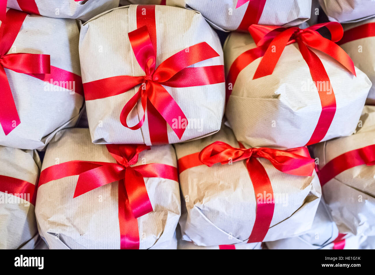 Stack of gift wrapped boxes in red ribbon and brown paper stock stack of gift wrapped boxes in red ribbon and brown paper negle Images