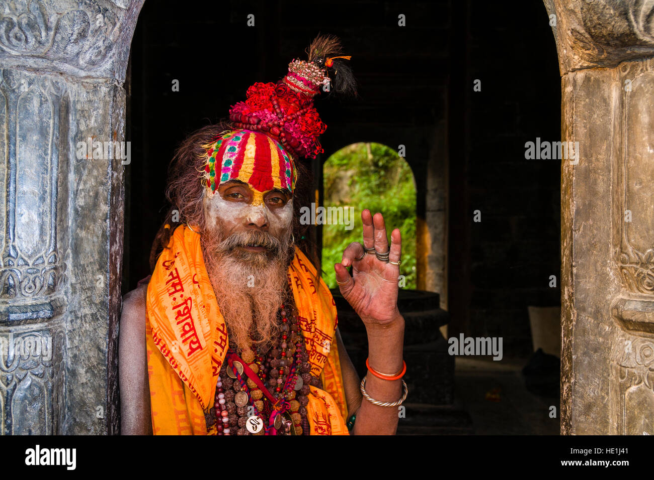Portait of a Sadhu, holy man, sitting at a little shrine at Pashupatinath temple at the banks of Bagmati River Stock Photo