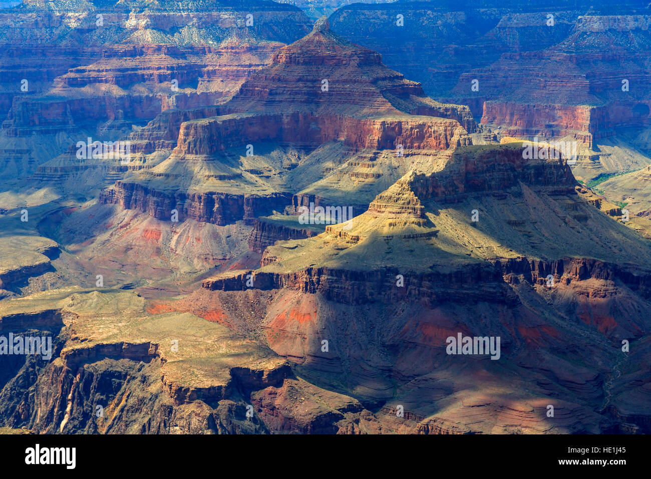 In this view shadows from the clouds move across the rock formations in Grand Canyon National Park, Arizona, USA - Stock Image