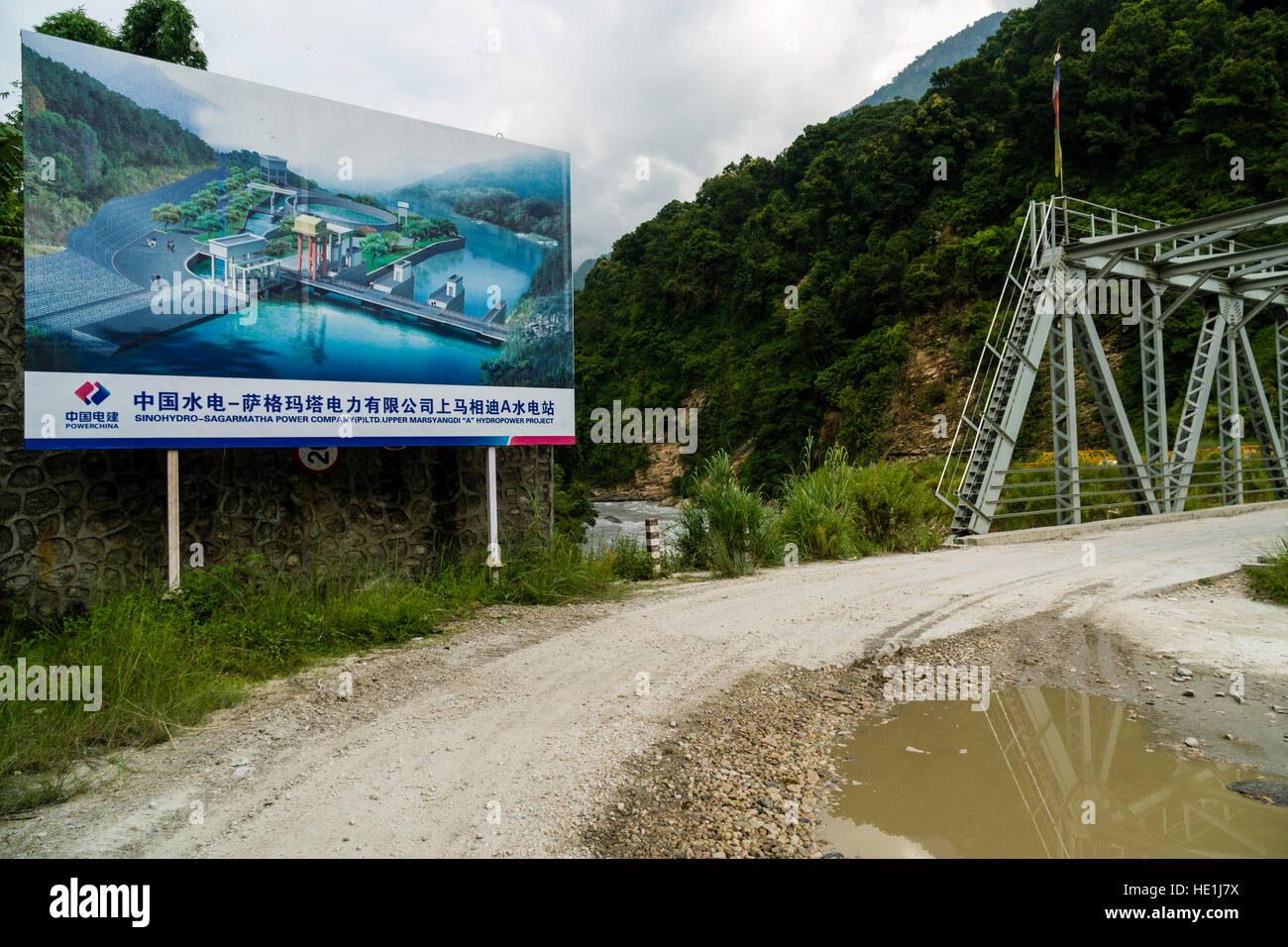 The future appearance of the chinese Upper Marsyangdi hydroelectric powerplant project is displayed on a big signboard - Stock Image