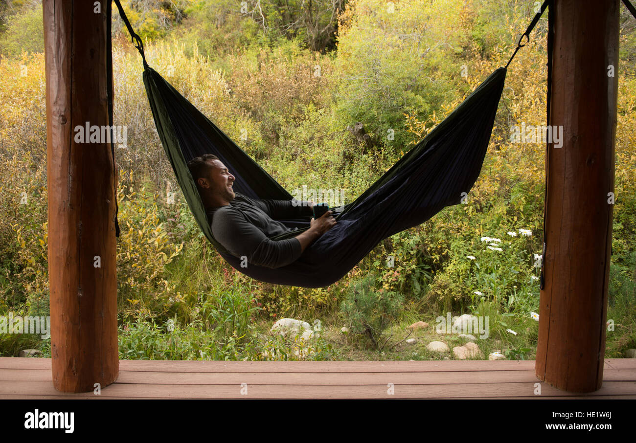 U.S. Air Force Staff Sgt. Gideon Connelly, 175th Wing, Maryland Air National Guard, chaplain assistant, relaxes - Stock Image