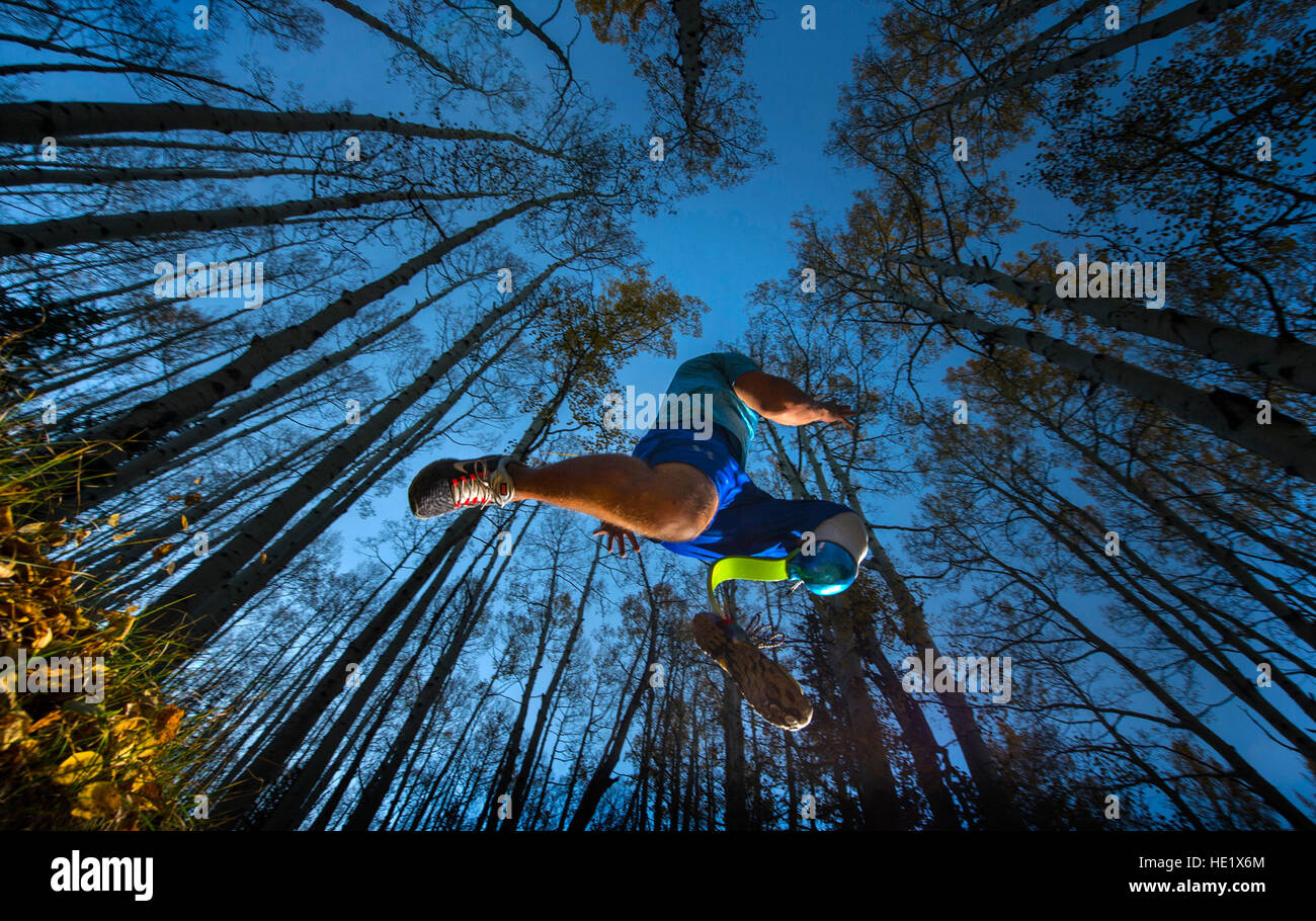 Staff Sgt. Gideon Connelly leaps over a gutter during training at an adaptive sports camp in Crested Butte, Colorado. - Stock Image