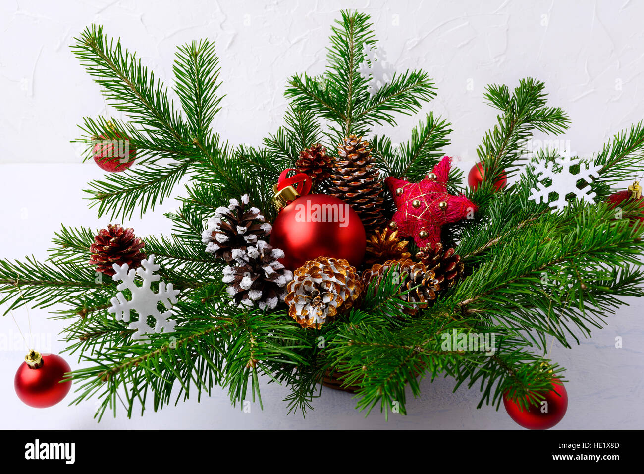 Christmas Greenery Centerpieces.Christmas Table Centerpiece With Red Balls And Hand