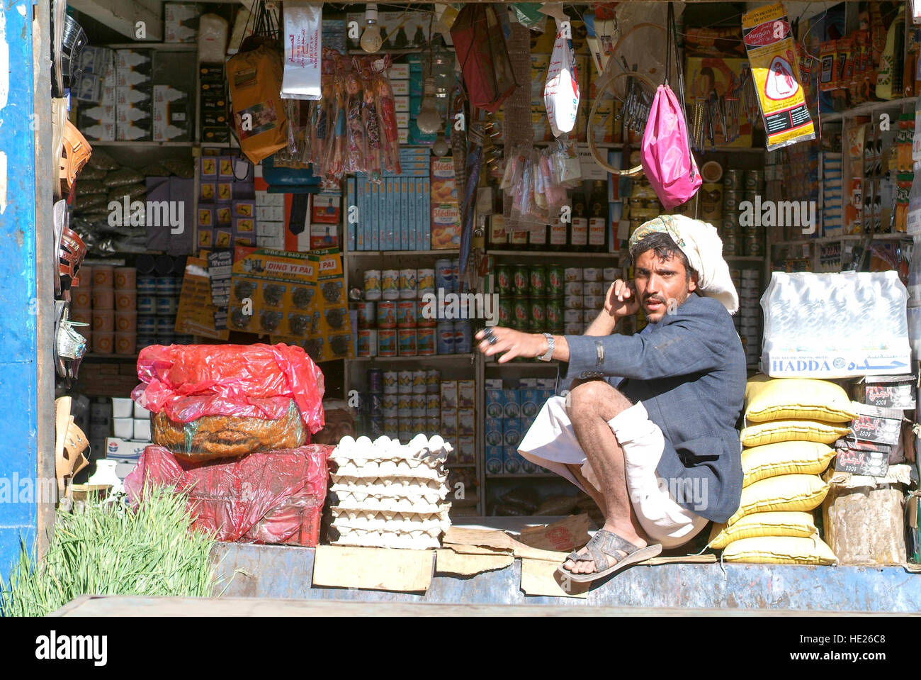 Habbabah, Yemen - 7 January 2008: man selling food on his small shop at Habbabah on Yemen - Stock Image