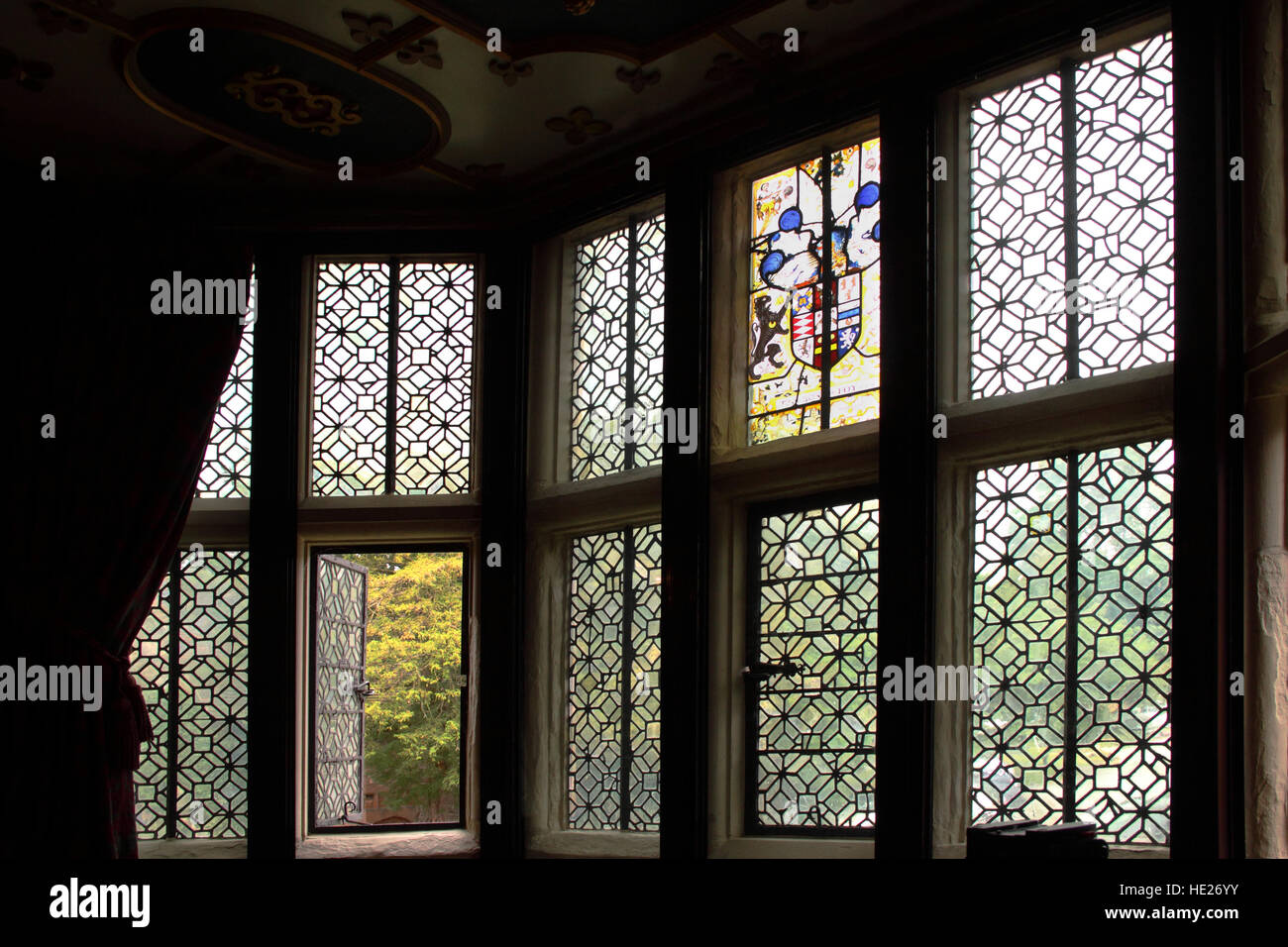 Leaded engraved medieval windows in the Great Chamber of New Hall Manor, now hotel, at Sutton Coldfield. - Stock Image