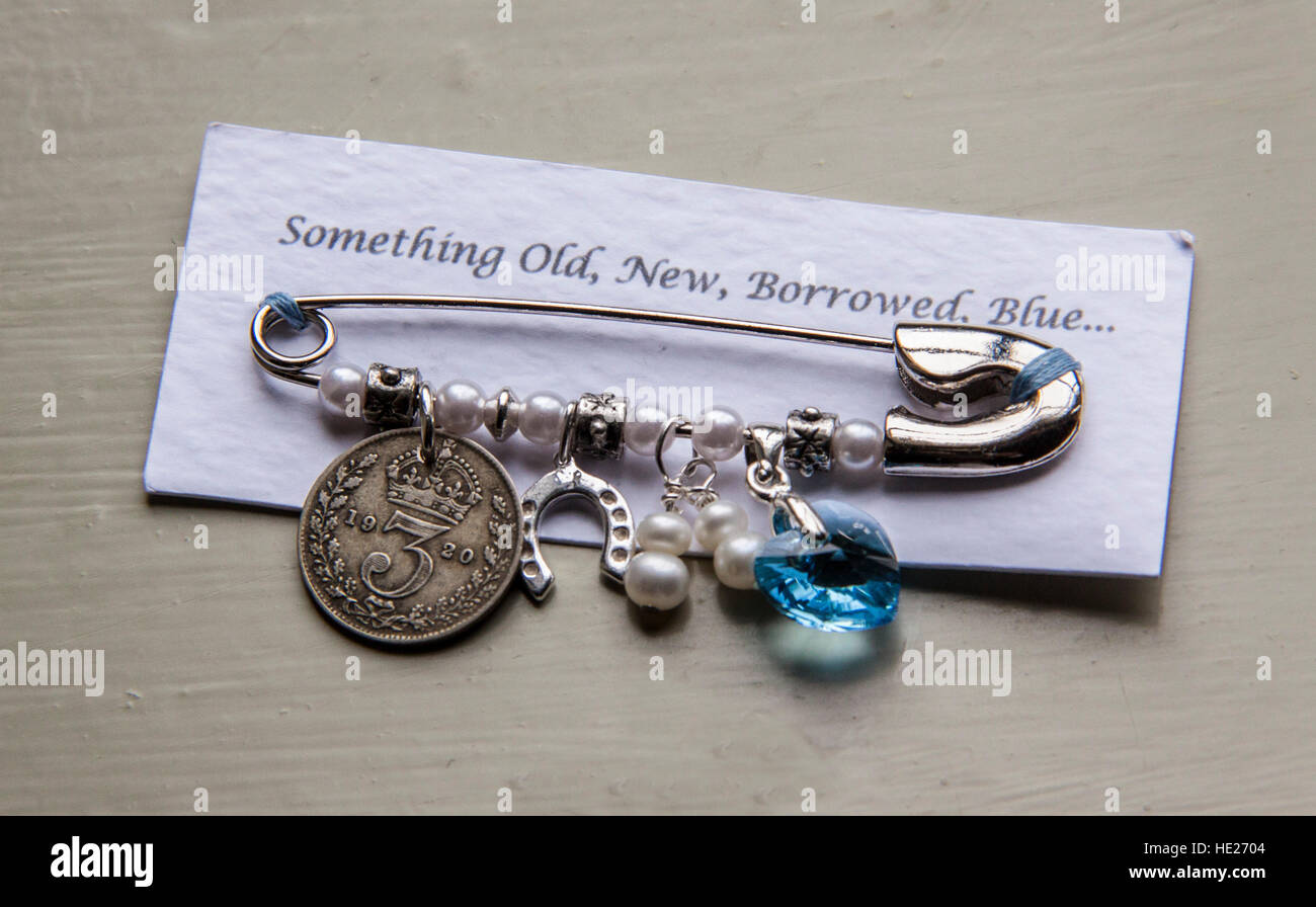 Something old, new, borrowed, blue, safety pin with coin, gemstone, lucky charms, pearls - Stock Image