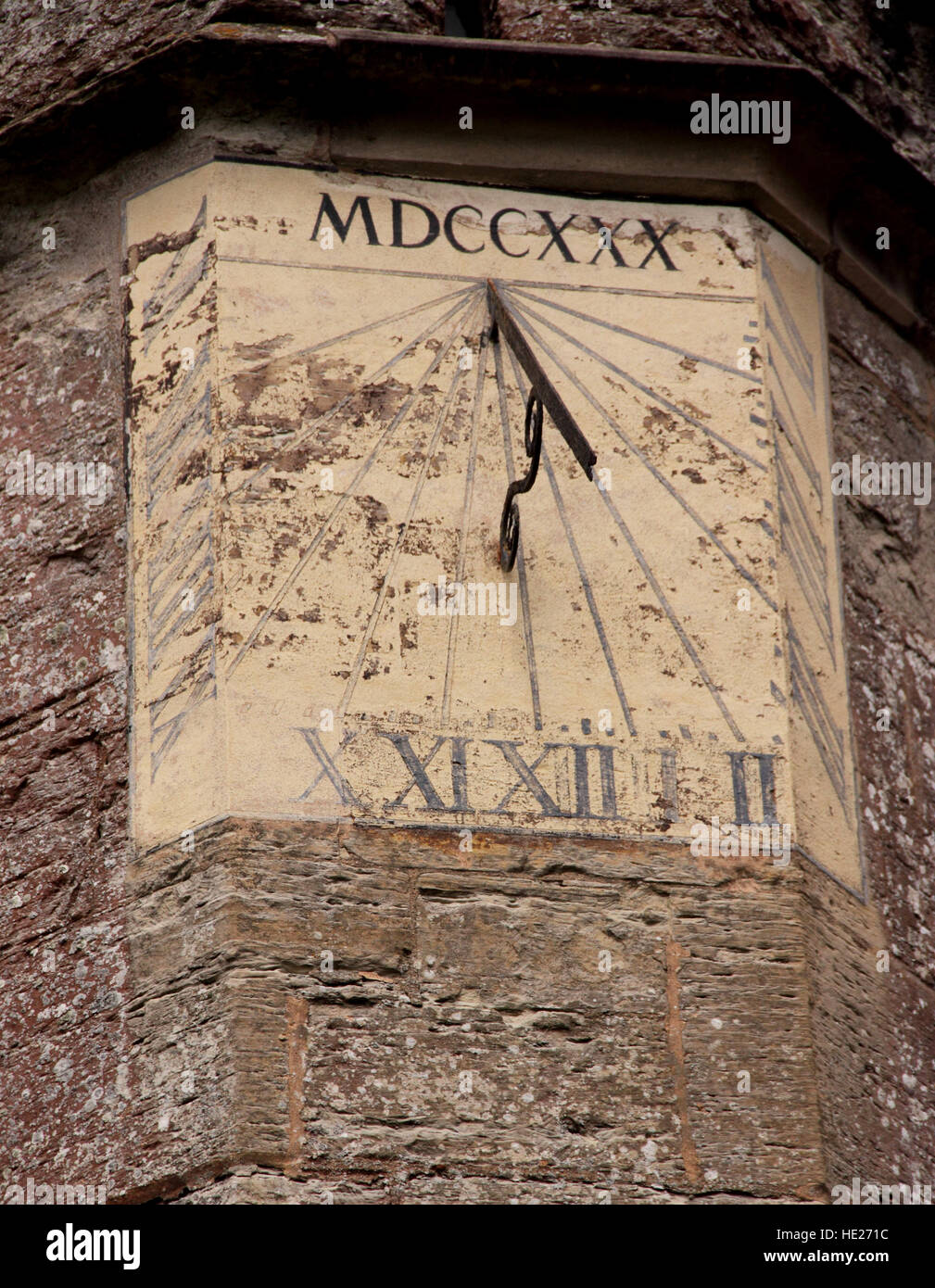 Sundial high on a church tower, roman numerals on the face, and dated MDCCXXX, or 1730 AD - Stock Image