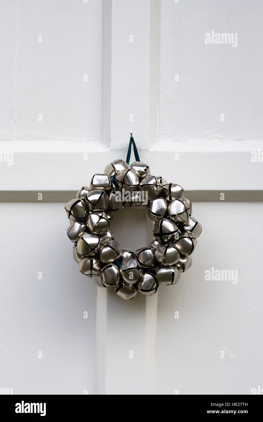 Decorative Christmas Wreath Hanging On A White Front Door.   Stock Image
