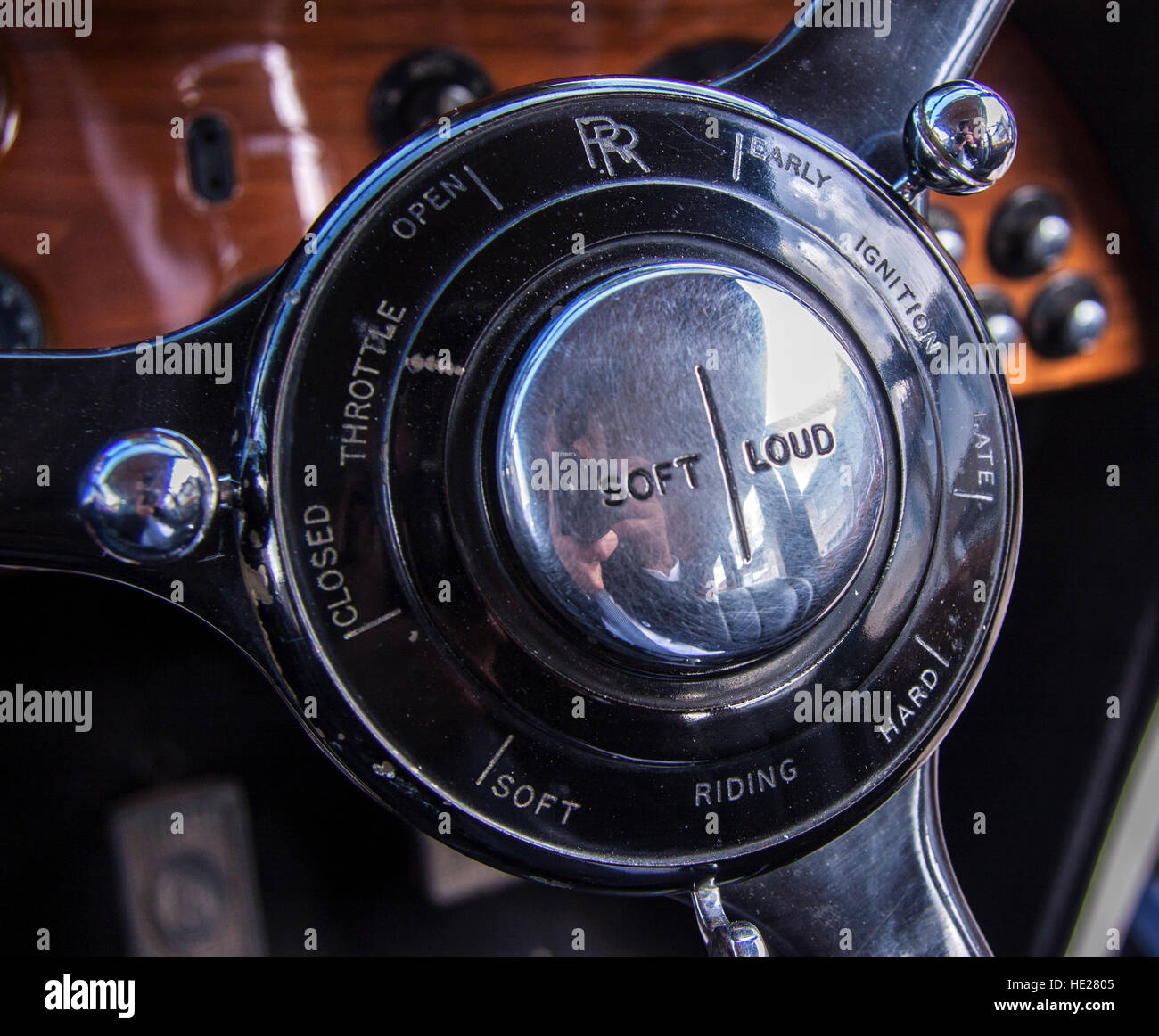 Steering wheel hub of a Rolls Royce Phantom III, controls for horn soft/loud, ride firmness, and ignition advance - Stock Image