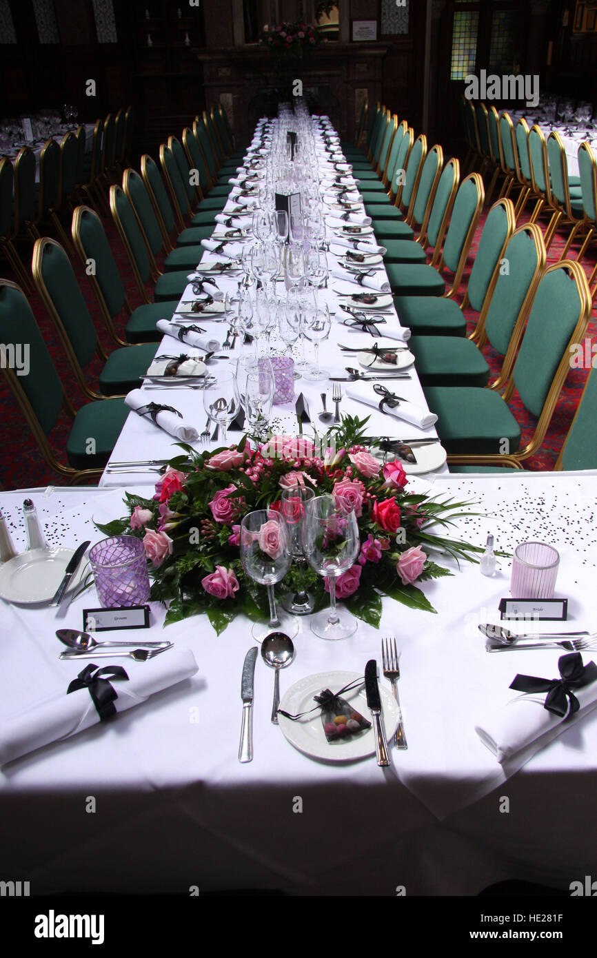 Tables laid for a large wedding breakfast at Highbury Hall, Birmingham, white linen, glasses, crockery, cutlery. - Stock Image