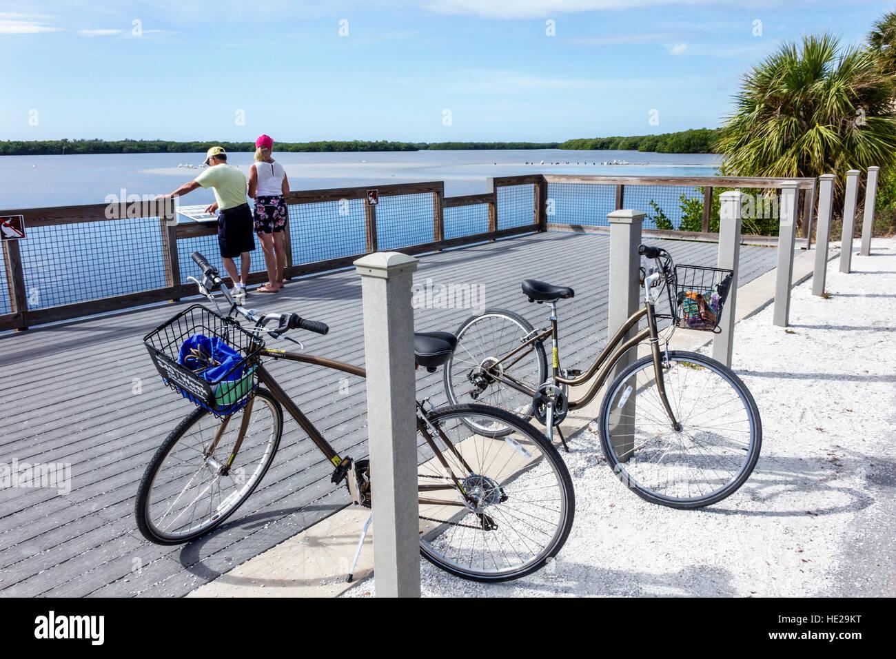 Sanibel Island Florida J. N. J.N. JN Ding Darling National Wildlife Refuge man woman couple bicycles Sanibel Bayou - Stock Image