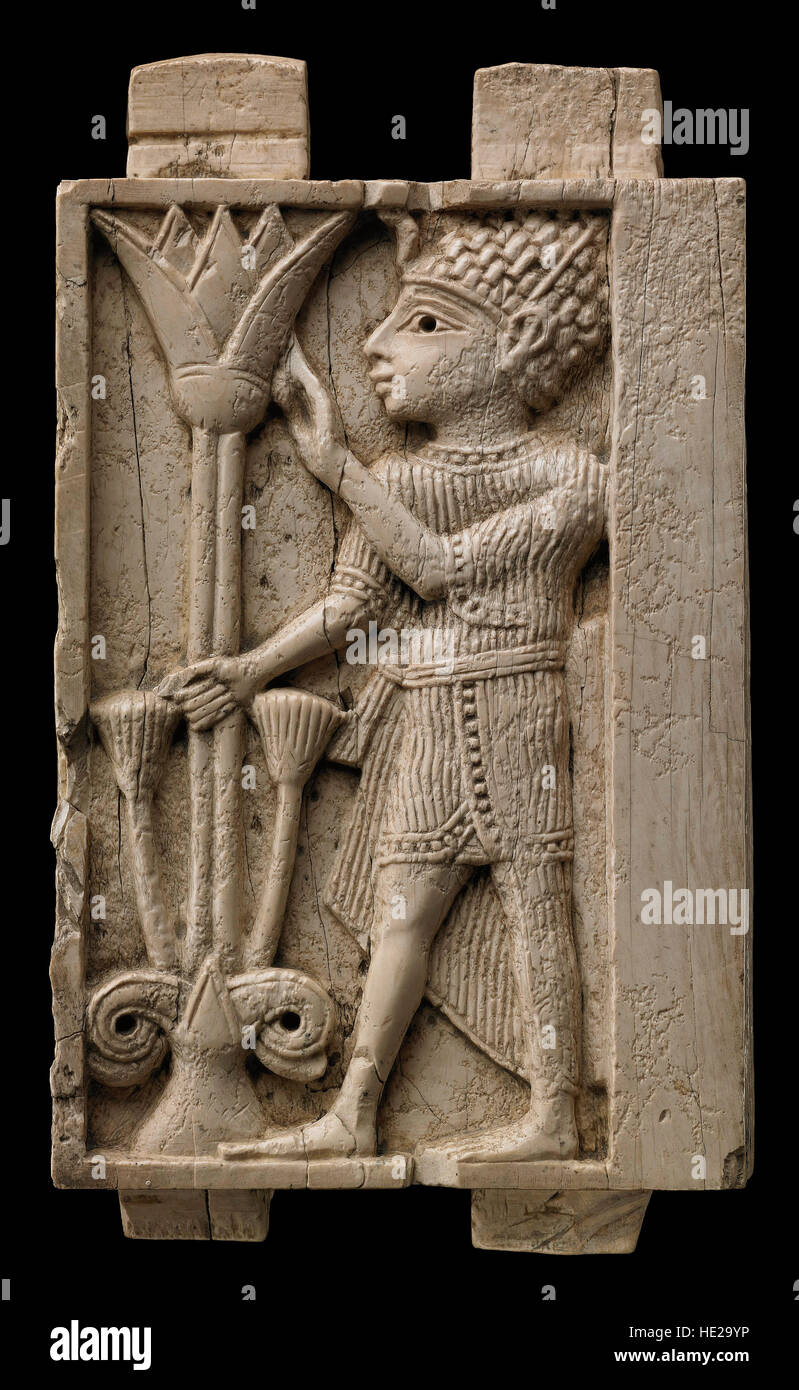 5997 Ivory Plaque Depicting An Egyptian Man Holding A Lotus Flower
