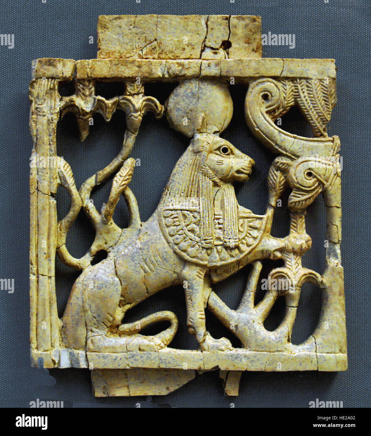 6007. Ivory plaque depicting a ram headed Sphinx. Nimrud, Mesopotamia, 9-8th. C. BC. - Stock Image