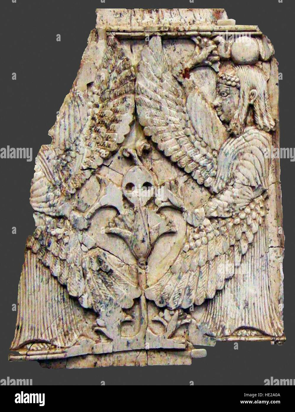 6015. Ivory plaque depicting winged creatures. Nimrud, Mesopotamia, 8-7th. C. BC. - Stock Image