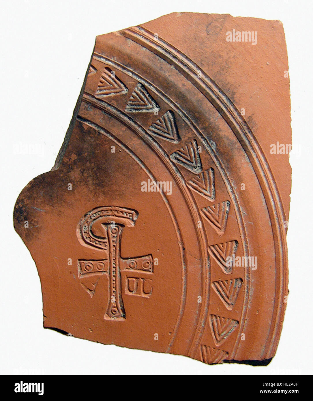 6017. Roman (North Africa) pottery sherd depicting the 'Chi Rho', a combination of letters that forms an abbreviation - Stock Image