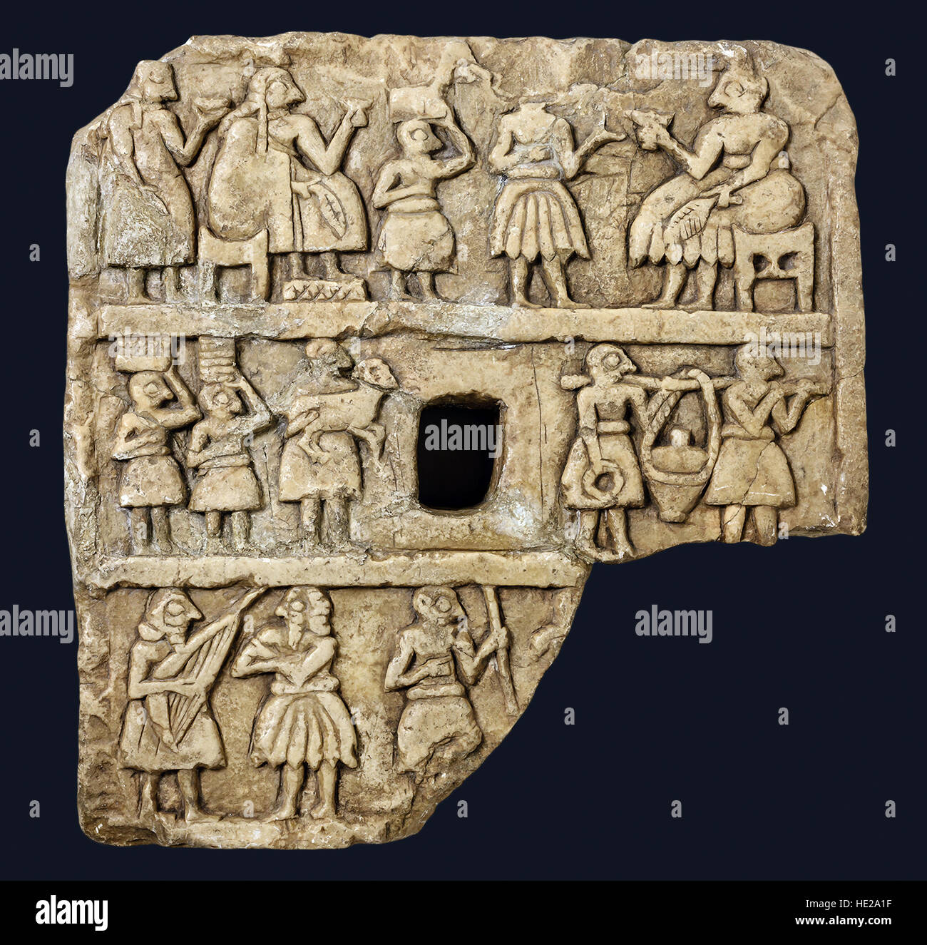 6025. Stone carved plaque depicting a scene of ritual feasting and musicians. Khafajeh, Iraq, Mesopotamia c. 2600 - Stock Image