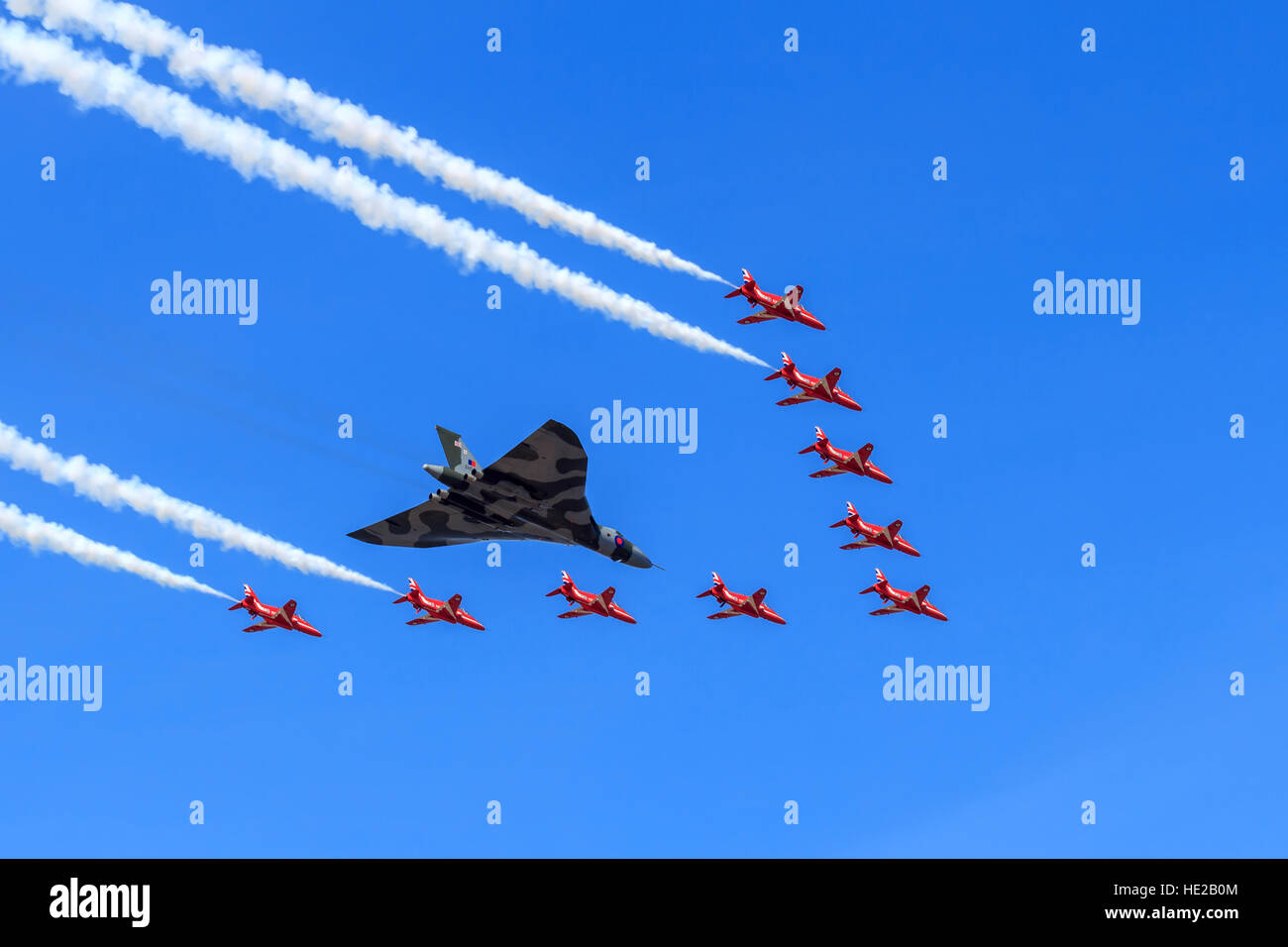 The RAF Avro Vulcan Bomber XH558 with The Red Arrows Vulcan tribute formation to celebrate the Vulcans last year - Stock Image