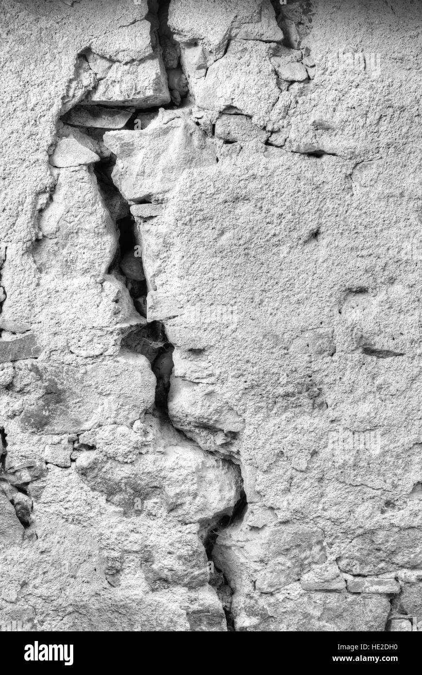 Big fissure in a house wall in black and white - Stock Image