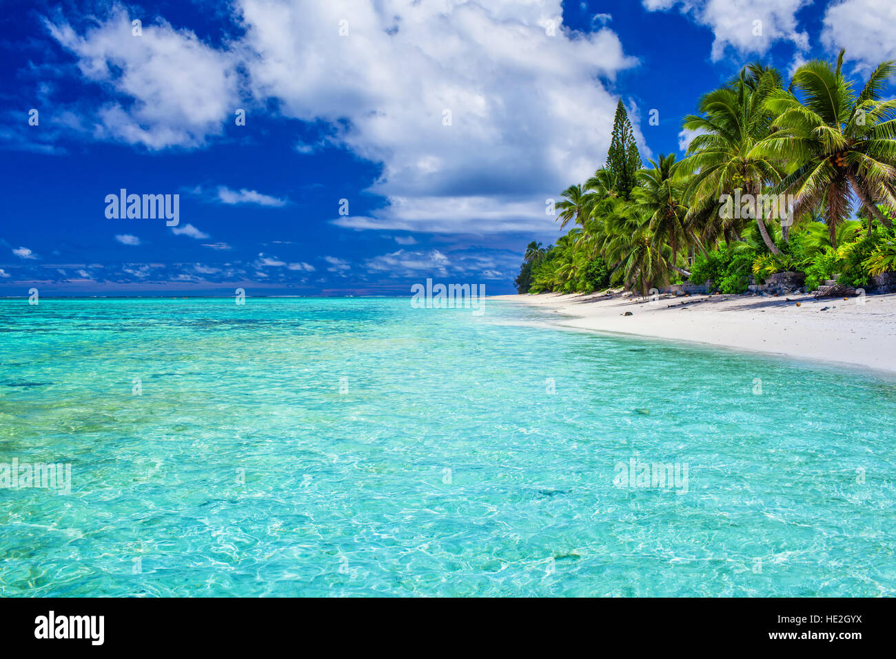 Amazing beach with white sand and palm trees on Rarotonga, Cook Islands - Stock Image