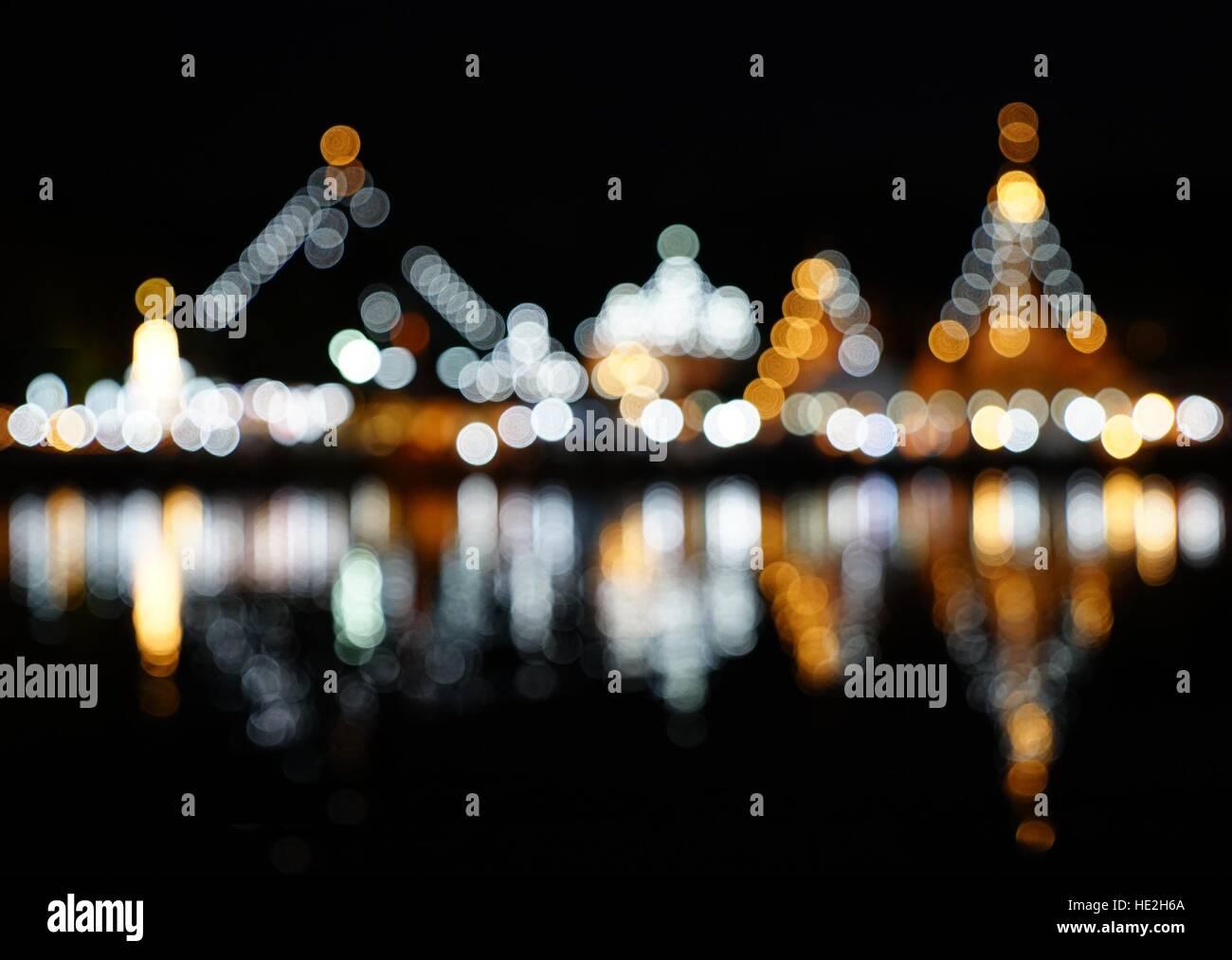 Abstract blurred bokeh light of Wat Chong Klang and Wat Chong Kham with water reflection, Mae Hong Son, Thailand - Stock Image