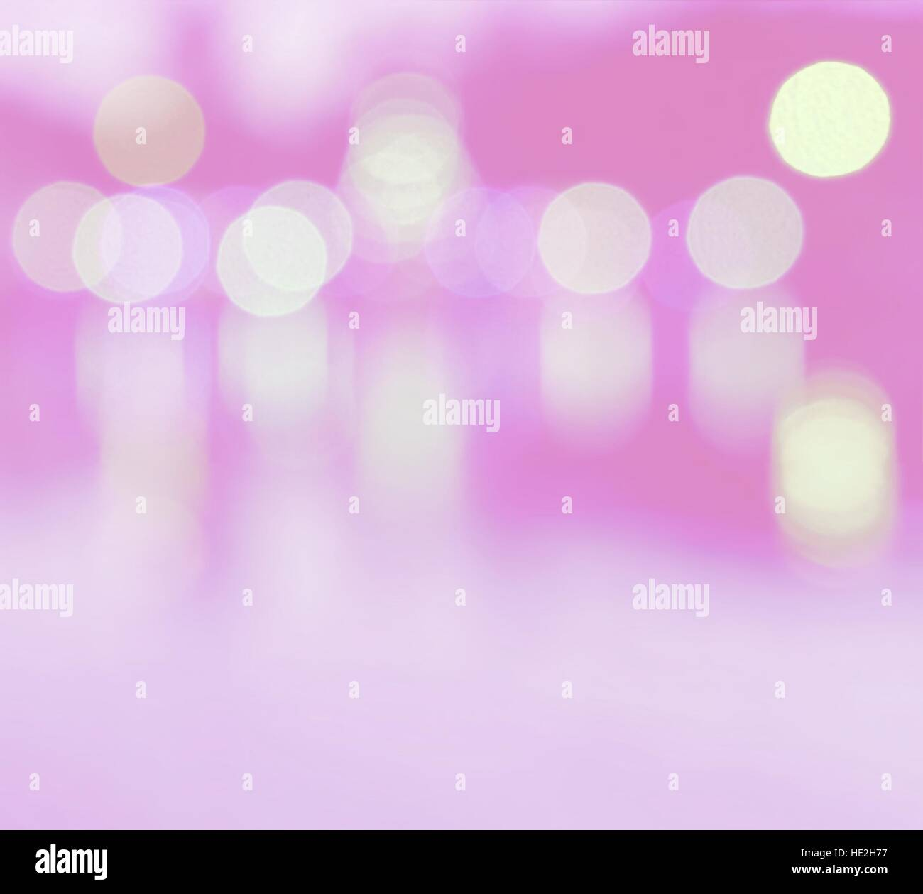 Abstract multicolor blurred bokeh light with water reflection on pink background - Stock Image