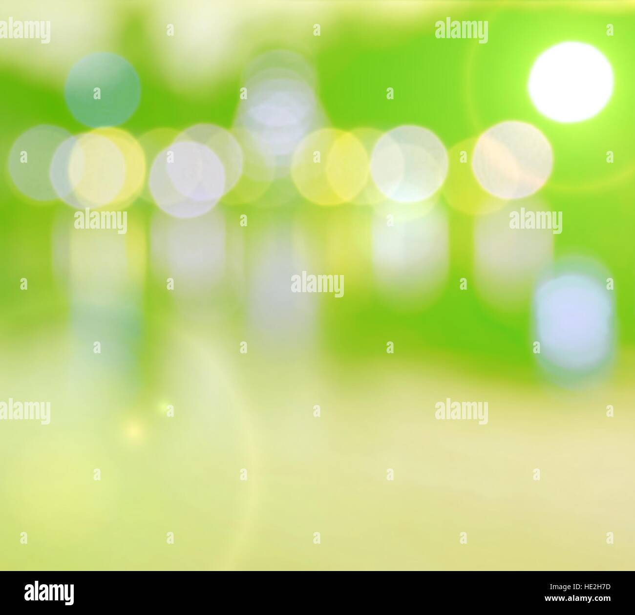 Abstract multicolor blurred bokeh light with water reflection and  lens flare effect on green yellow  background - Stock Image