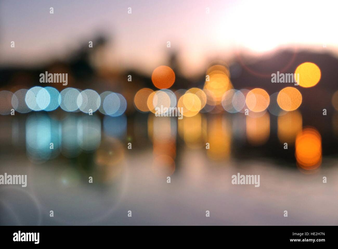 Abstract multicolor blurred bokeh light with water reflection and lens flare effect - Stock Image