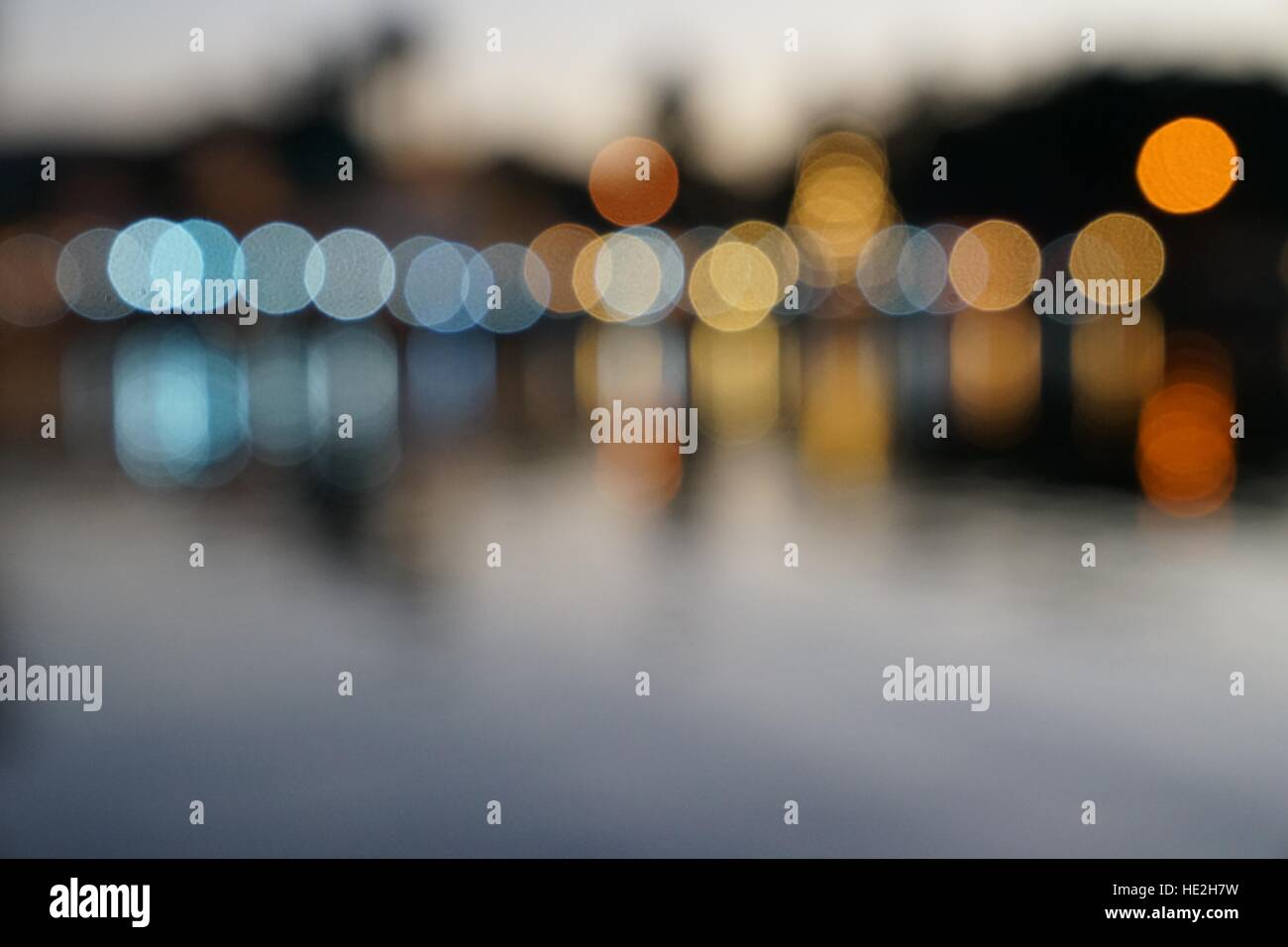 Abstract multicolor blurred bokeh light with water reflection - Stock Image
